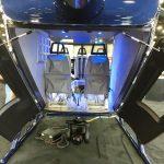 Novo helicóptero monomotor SH09, com proposta de configuração para aviação de segurança pública. - detalhe das portas traseira tipo concha.